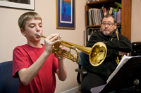 John Worley with Trumpet Student